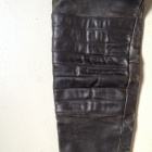 Damen black leather pants knee